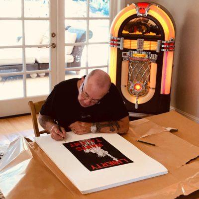 Bernie Taupin signing artwork